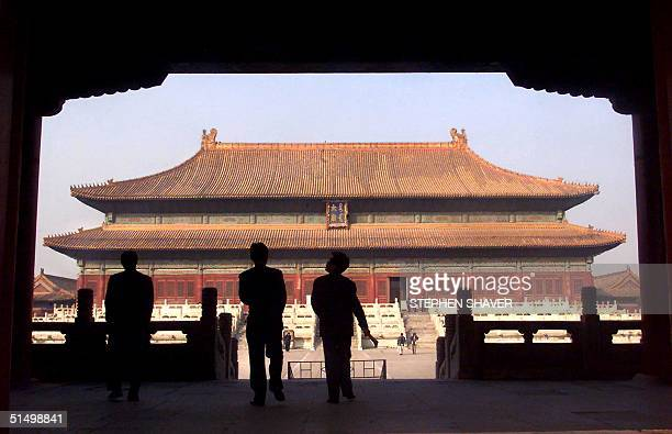 Chinese tourists walk 27 March 2001 through the heart of Beijing's historic Forbidden City once the exclusive preserve of China's emperors The Three...