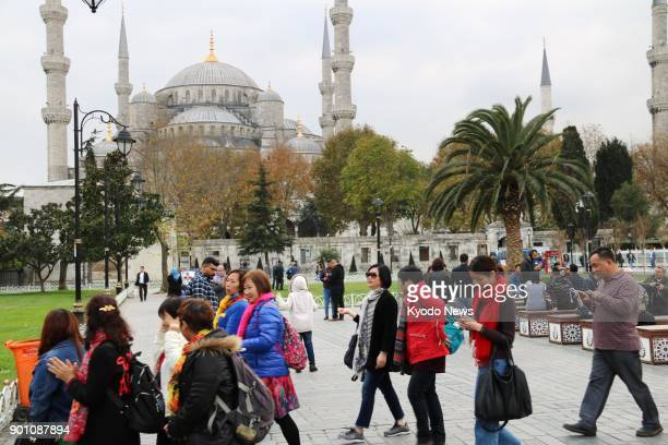 Chinese tourists walk near the Blue Mosque in the Sultanahmet district of Istanbul on Nov 17 2017 More Chinese tourists are expected to visit as...