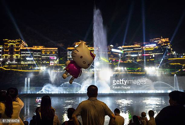 Chinese tourists watch a water and light show on the Chishui River on September 22 2016 in MaotaiGuizhou province China Distillers in the famous...