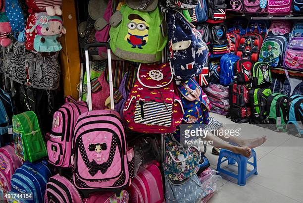 Chinese trader waits for customers at her stall selling wholesale bags at the Yiwu International Trade City on September 19 2015 in Yiwu China...