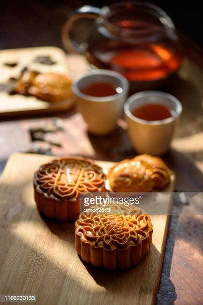 chinese traditional festival mid-autumn moon cake and chinese tea - moon cake stock pictures, royalty-free photos & images