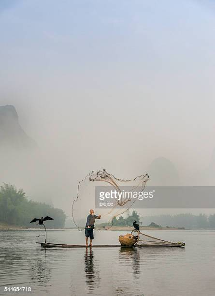 Chinese traditional fisherman with cormorants fishing, Li River China