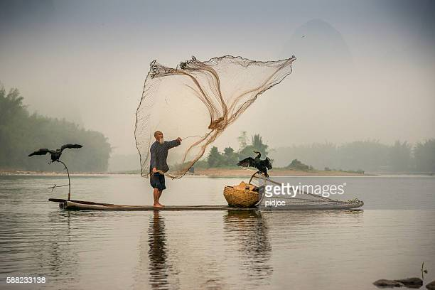 Chinese traditional fisherman with cormorants fishing, Li River China