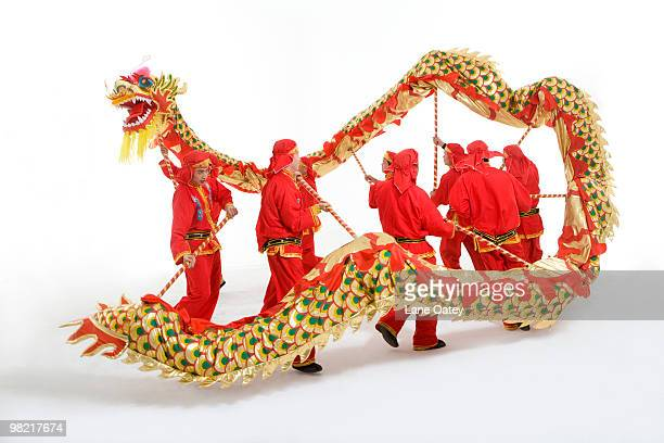 chinese traditional lion dancing - chinese dragon stock photos and pictures