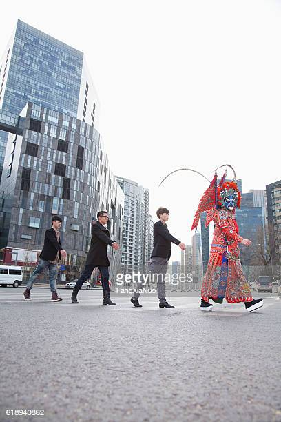 Chinese traditional opera singer crossing street in city