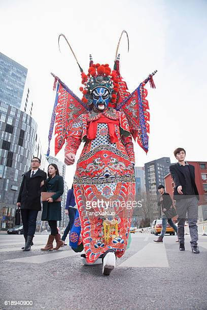chinese traditional opera singer crossing street in city - chinese opera stock-fotos und bilder