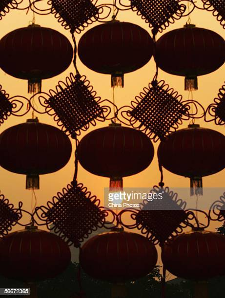 Chinese traditional red lanterns and Chinese knots hung to mark the upcoming Chinese new year are seen at sunset at a street on January 26 2006 in...