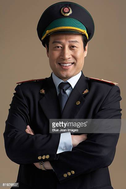 Chinese train conductor, portrait