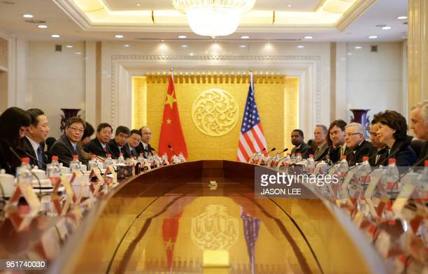 Chinese Transport Minister Li Xiaopeng speaks to US Secretary of Transportation Elaine Chao during a meeting at the Ministry of Transport of China in...