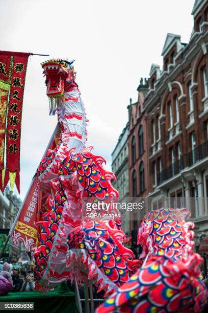Chinese tributional dragon dance being performed in Chinatown Londoners gather in London's chinatown and trafalgar square to celebrate Chinese new...