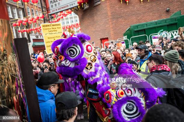 Chinese tributional dragon dance being performed Londoners gather in London's chinatown and trafalgar square to celebrate Chinese new year 2018