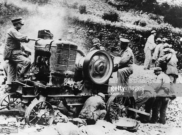 Chinese troops of the People's Liberation Army use cement mixers to construct a road through Tibet following their invasion of the country 1950