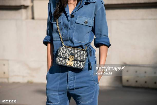 Chinese TV host Linda Li Jing wears a Dior jumpsuit and bag day 1 of Paris Womens Fashion Week Spring/Summer 2018 on September 26 2017 in Paris France