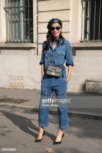 Chinese TV host Linda Li Jing wears a Dior jumpsuit shoes hat and bag day 1 of Paris Womens Fashion Week Spring/Summer 2018 on September 26 2017 in...