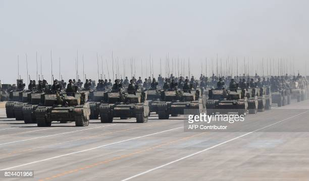 Chinese Type 99A tanks take part in a military parade at the Zhurihe training base in China's northern Inner Mongolia region on July 30 2017 China...