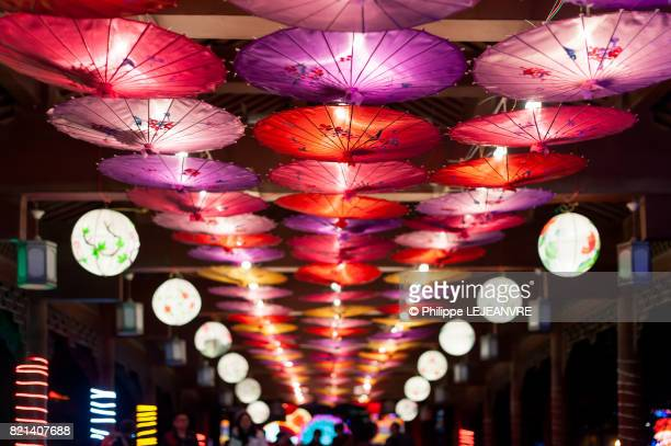 Chinese umbrellas hanging on a corridor ceiling for the lantern