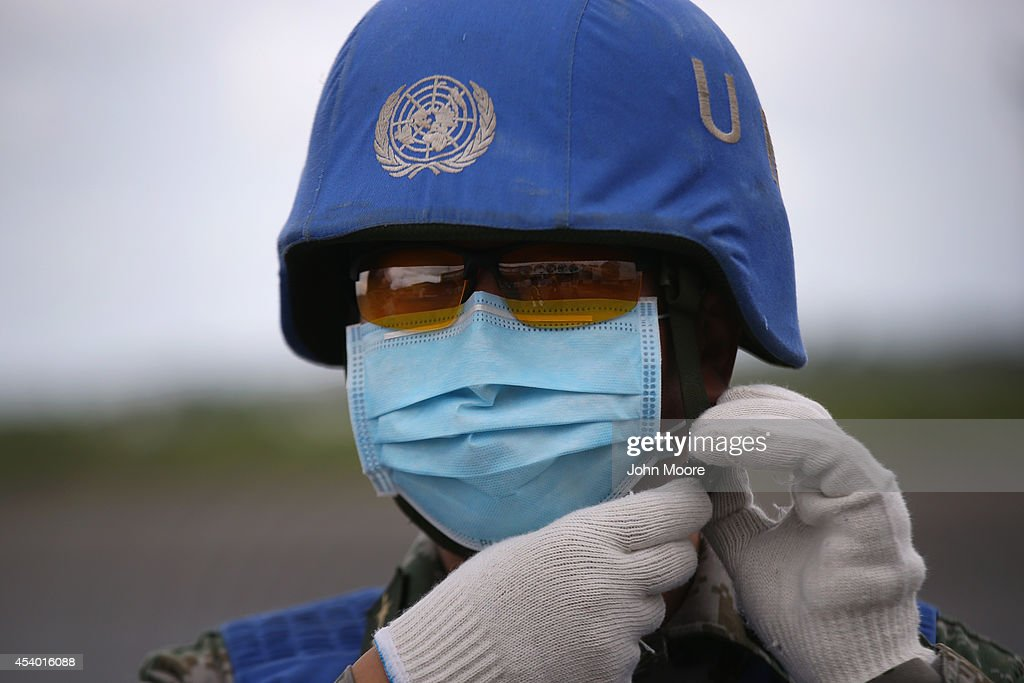 A Chinese UN soldier prepares a truckload of Ebola relief aid after it was airlifted by the United Nations Children's Fund (UNICEF), on August 23, 2014 in Harbel, Liberia. The cargo plane arrived from Belgium carrying 75 tons (68 metric tons), of medical and hygiene supplies supplied by UNICEF with support from the US Office of Disaster Assistance to help contain the worst Ebola epidemic in history. It was the largest UN airlift of Ebola relief to arrive to Liberia, where international aid agencies and the Liberian government have been struggling to contain the epidemic of the deadly virus. The shipment included 30 tons of concentrated chlorine for disinfection, almost 1 million latex gloves, itravenous fluids, oral rehydration salts and therapeudic foods for patients undergoing treatment. The emergency items will be distributed by the Liberian Ministry of Health to 470 health facilities nationwide, according to UNICEF. The deadly virus has killed at least 1,400 people in West Africa and more in Liberia than any other country.