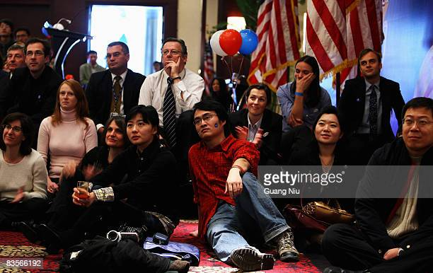 Chinese university student watches a live screening as US presidentelect Barack Obama takes his acceptance speech after defeating John McCain in the...