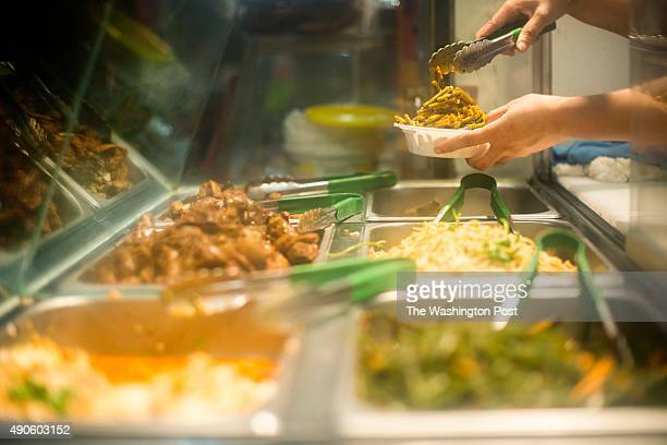 Chinese vegetable dishes are served at the Chinese Golden Mall in Flushing Queens New York Sunday September 20 2015