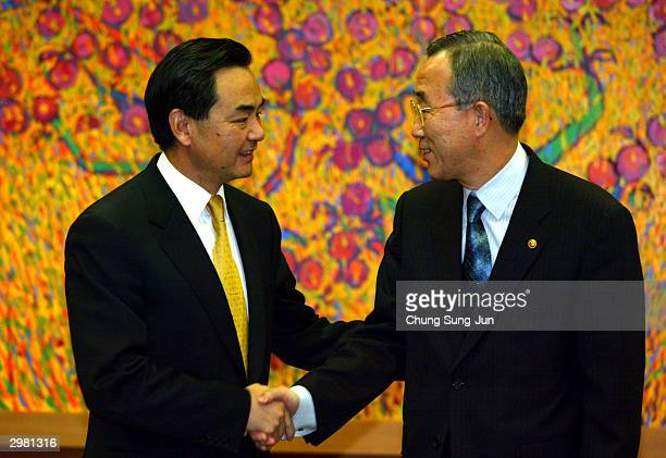Chinese Vice Foreign Minister Wang Yi shakes hands with South Korean Foreign Minister Ban KiMoon before a meeting to discuss the North Korean nuclear...