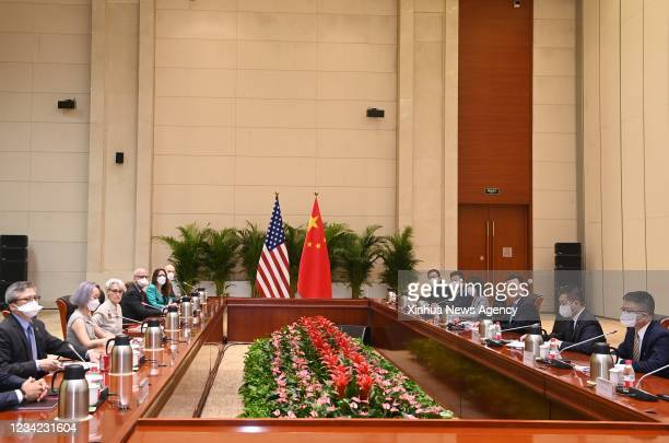 Chinese Vice Foreign Minister Xie Feng 3rd R holds talks with U.S. Deputy Secretary of State Wendy Sherman 3rd L in north China's Tianjin on July 26,...