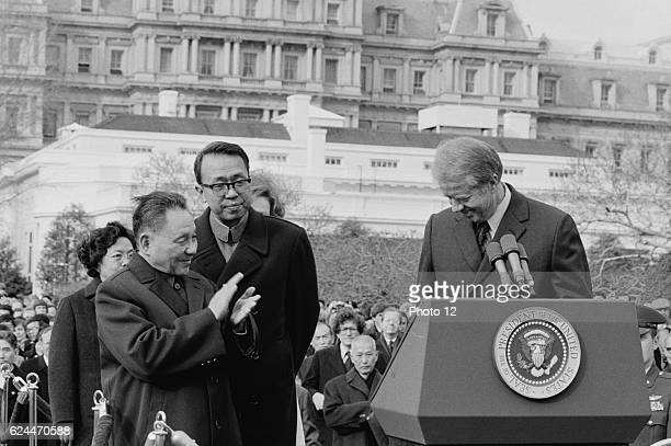 Chinese Vice Premier Deng Xiaoping applauds as US President Jimmy Carter stands behind a podium at the White House, Washington, D.C. January 1979.
