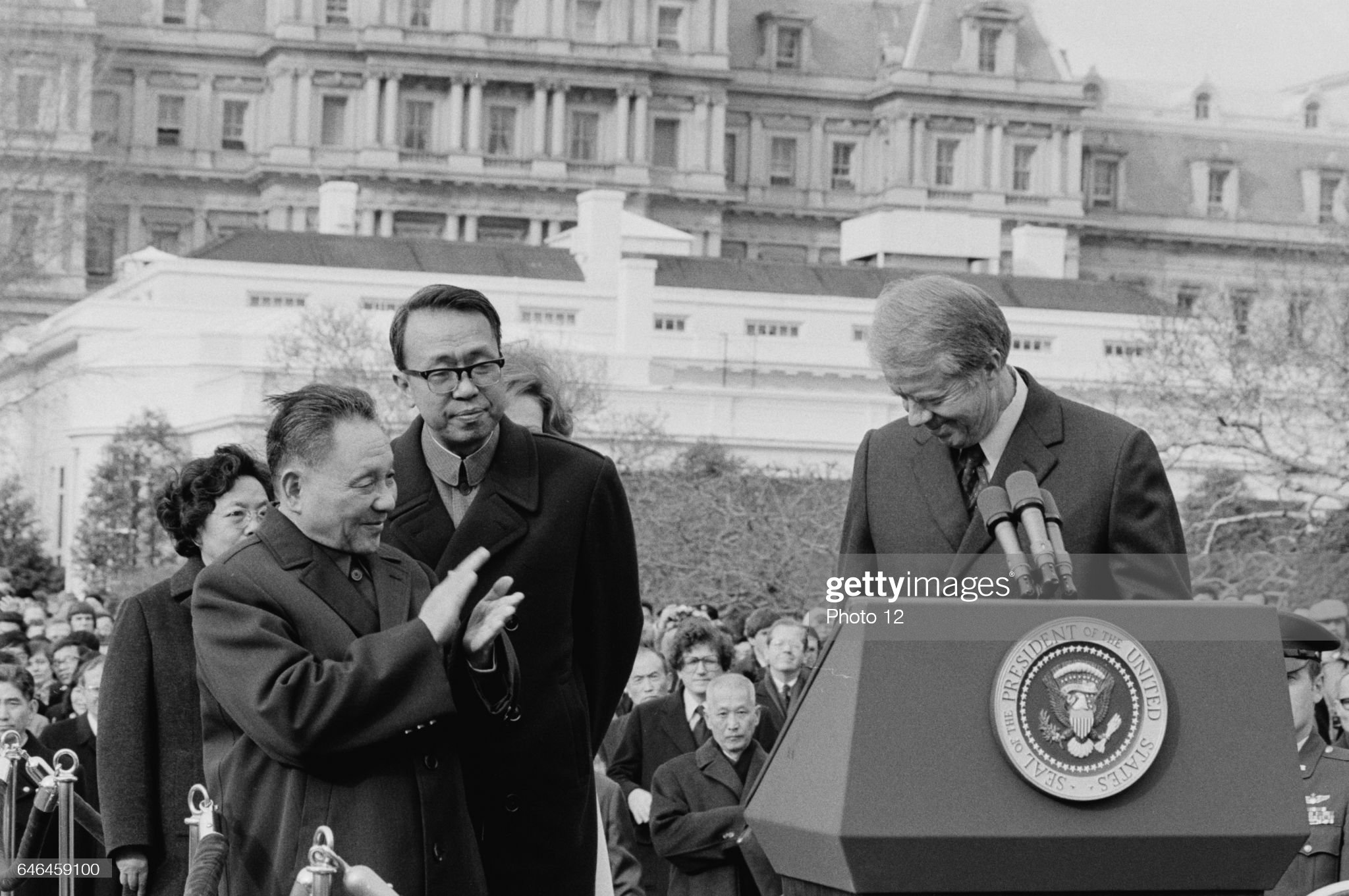 Chinese Vice Premier Deng Xiaoping applauds as US President Jimmy Carter, 1979 : News Photo