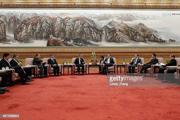 Chinese Vice Premier Li Keqiang speaks with JeanPascal Tricoire chairman and chief executive officer of Schneider Electric SA during the China...