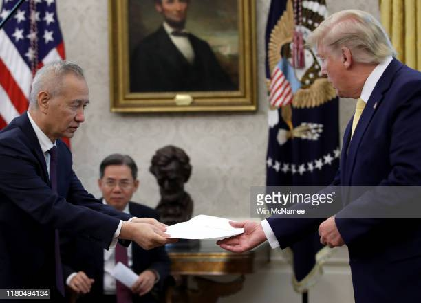 """Chinese Vice Premier Liu He presents U.S. President Donald Trump with a letter from Chinese President Xi Jinping after Trump announced a """"phase one""""..."""