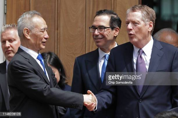 Chinese Vice Premier Liu He says goodby to US Treasury Secretary Steven Mnuchin and US Trade Representative Robert Lighthizer as they break from...