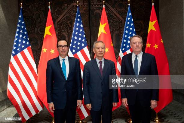 Chinese Vice Premier Liu He with United States Trade Representative Robert Lighthizer and Treasury Secretary Steven Mnuchin pose for photos before...