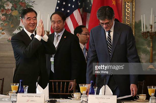 Chinese Vice Premier Wang Yang gestures as he arrives with US Secretary of the Treasury Jacob Lew at a CEO Roundtable at the Blair House June 24 2015...