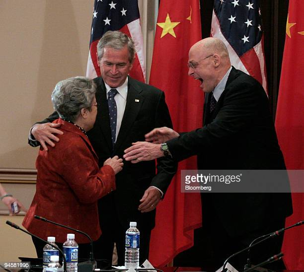Chinese Vice Premier Wu Yi left meets with US President George W Bush center and Treasury Secretary Henry Paulson at the Eisenhower Executive Office...