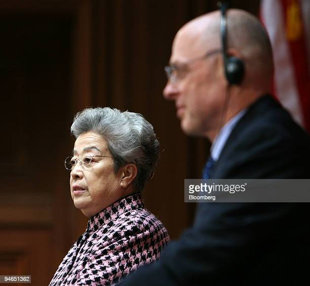 Chinese Vice Premier Wu Yi left reads a closing statement while US Treasury Secretary Henry Paulson listens at the conclusion of the second meeting...