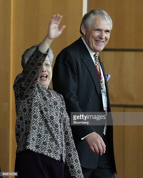 Chinese Vice Premier Wu Yi waves as she is escorted from a conference hall by Pacific Basin Economic Council Chairman David Eldon where she spoke to...