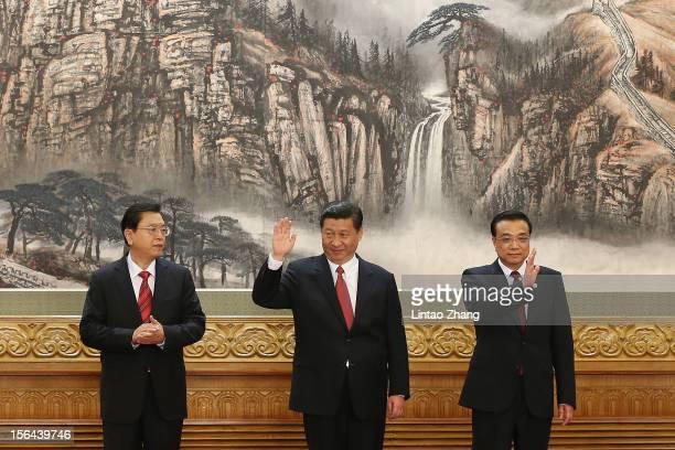 Chinese Vice Premier Zhang Dejiang, Chinese Vice President Xi Jinping and Chinese Vice Premier Li Keqiang greets the media after Xi Jimping was...