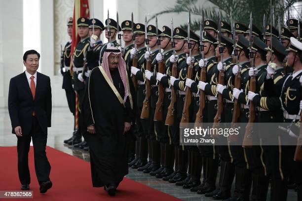 Chinese Vice President Li Yuanchao invites Saudi Crown Prince Salman bin Abdulaziz to view an honour guard during a welcoming ceremony inside the...