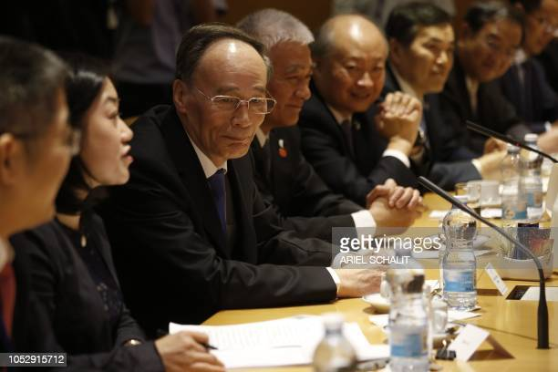 Chinese Vice President Wang Qishan listens during a meeting with Israeli Prime Minister Benjamin Netanyahu in Jerusalem on October 24, 2018. - Qishan...