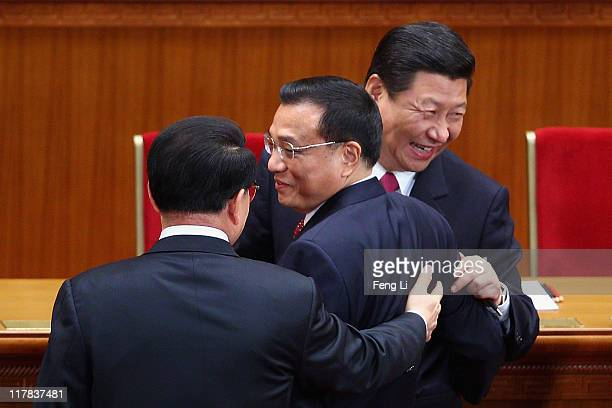 Chinese Vice President Xi Jinping and Chinese Vice Premier Li Keqiang react as they chat with Li Changchun a member of the Standing Committee of the...