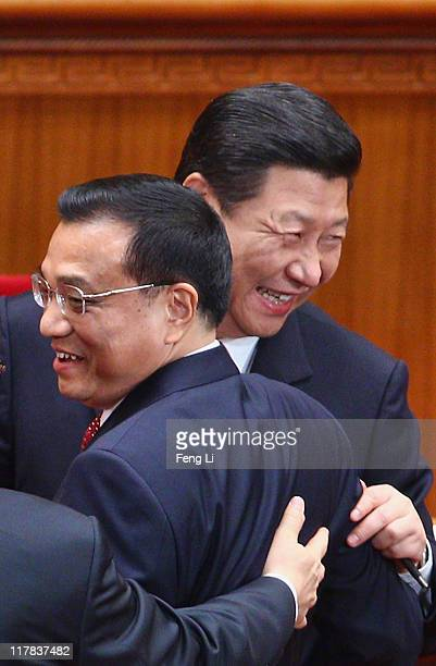 Chinese Vice President Xi Jinping and Chinese Vice Premier Li Keqiang react as they chat with Li Changchun, a member of the Standing Committee of the...