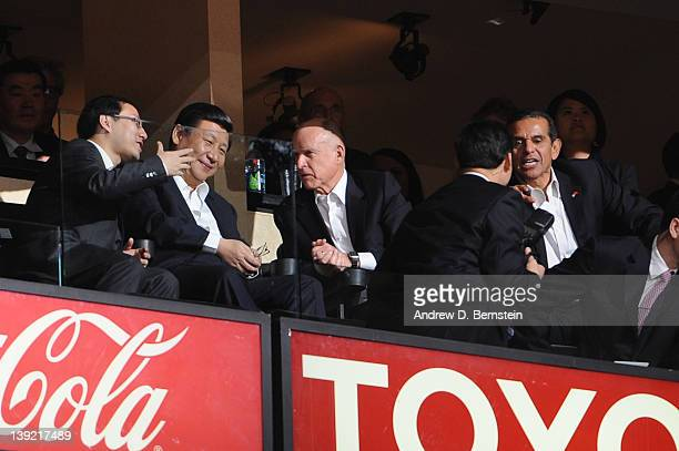 Chinese Vice President Xi Jinping California Governor Jerry Brown and Los Angeles Mayor Antonio Villaraigosa look on from a suite during a game...