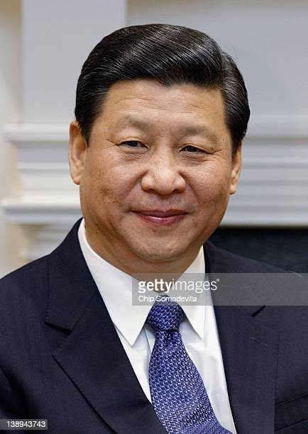 Chinese Vice President Xi Jinping makes brief remarks before an expanded bilateral meeting with US Vice President Joe Biden and other US and Chinese...