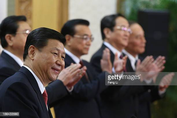 Chinese Vice President Xi Jinping one of the members of new sevenseat Politburo Standing Committee delivers a speech as Zhang Dejiang Li Keqiang Yu...