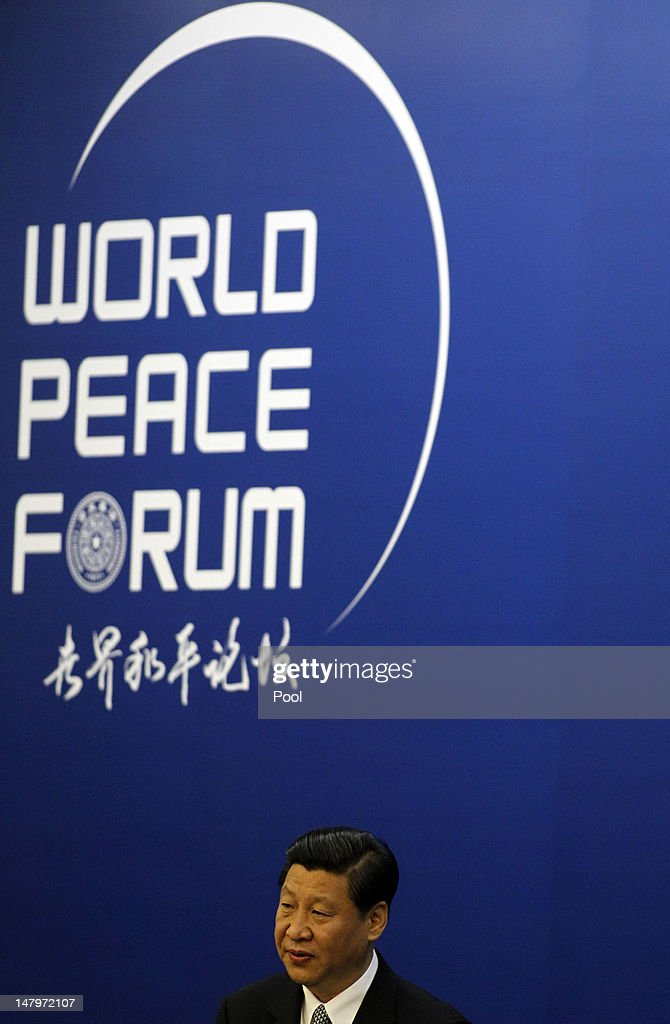 Chinese Vice President Xi Jinping speaks at the opening ceremony of the World Peace Forum held July 7, 2012 in Beijing, China.