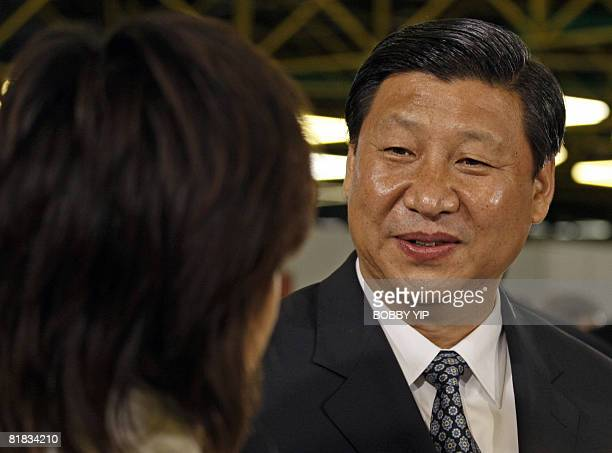 Chinese Vice President Xi Jinping speaks to local swimmer Sherry Tsai at the Olympic Games equestrian venue in Hong Kong on July 6 2008 Xi Jinping...