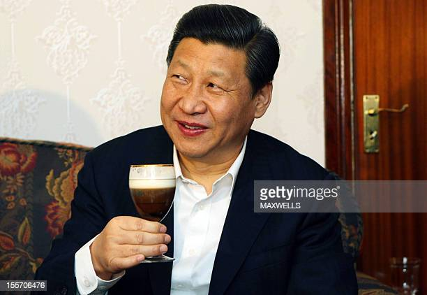 Chinese Vice President Xi Jinping tries one of farmer James Lynch's Irish Coffee during a visit to the Lynch Farm at Six Mile Bridge on February 19...