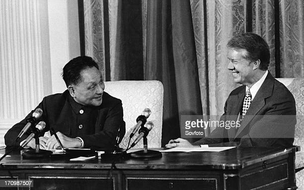 Chinese vice-premier deng xiaoping and us president jimmy carter during the signing of the us/china scientific and technological cooperation...