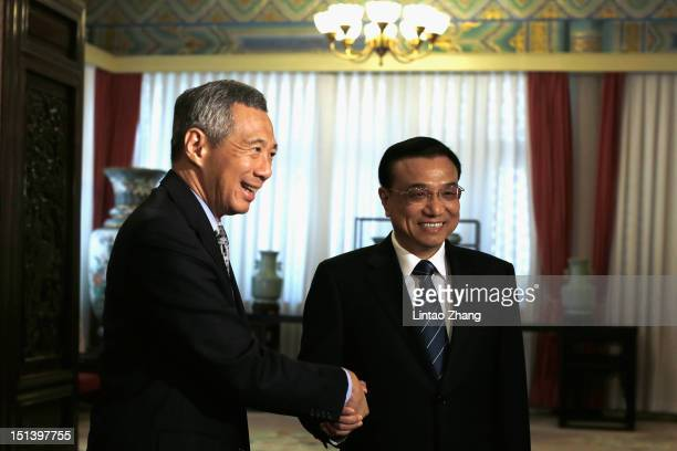 Chinese VicePremier Li Keqiang shakes hands with Singapore Prime Minister Lee Hsien Loong at the Ziguangge Pavilion in the Zhongnanhai leaders'...