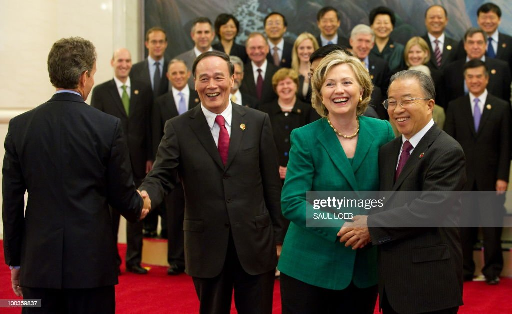 Chinese Vice-Premier Wang Qishan (2nd L) and Chinese State Councilor Dai Bingguo (R), greet US Secretary of State Hillary Clinton (2nd R) and US Secretary of Treasury Timothy Geithner (L) prior to a family photo with US and Chinese officials at the Great Hall of the People in Beijing on May 24, 2010, during the start of the second round of the US-China Strategic & Economic Dialogue. The US and China opened two days of high-level talks due to cover a wide range of issues including tensions over the sinking of a South Korean warship, blamed on Pyongyang. AFP PHOTO / POOL / Saul LOEB