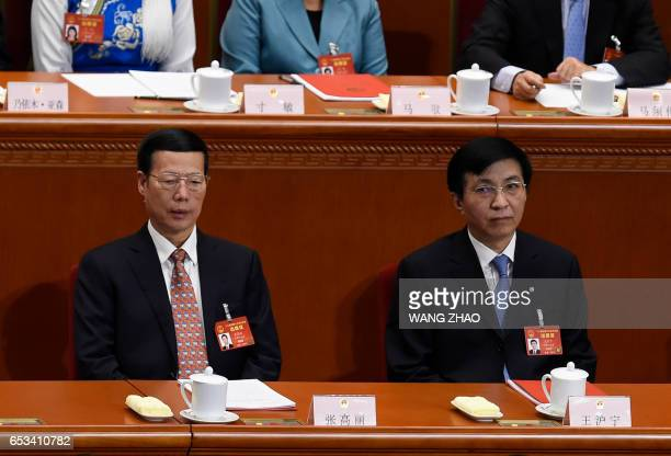 Chinese VicePremier Zhang Gaoli and Wang Huning a member of the Political Bureau of the CPC Central Committee attend the closing ceremony of the...